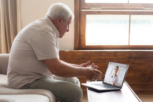 senior looking at laptop